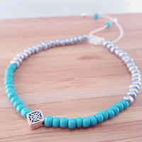 Vibrant turquoise and silver beaded friendship bracelet // glass turquoise seed beads // matte silver seed beads // silver plated focal bead