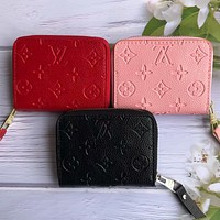 LV Louis Vuitton classic embossed letters men and women solid color zipper small wallet key case