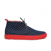 Men's Navy and White Polka Dot Water Repellent Sunbrella Alto Chukka Sneaker with Navy Leather Laces. Red Margom Sole with Laser Engraved Logo. Signature Red Leather Heel Tab. Leather Lined. Handmade in Italy.