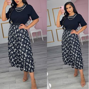 Louis Vuitton Fashion Women With short sleeves Top Long skirt two-piece
