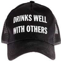 Drinks Well With Others Trucker Hat in Black and White Lettering