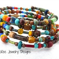 Wrap around memory wire bracelet, with Czech glass, wood, copper metal and Indonesian glass.