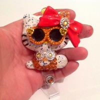 Catching Rays In Style Hello Kitty Retractable Reel Id Badge Holder