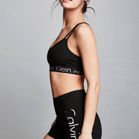 Calvin Klein Performance Strappy Back Logo Sports Bra | Urban Outfitters