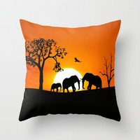 Elephant silhouettes at sunset Throw Pillow by Laureenr