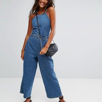 ASOS Denim Jumpsuit With Lace Up Back in Vintage Wash at asos.com