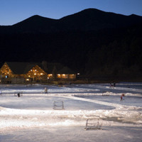 Ice Skating and Hockey on Evergreen Lake, Colorado, USA Photographic Print by Chuck Haney at AllPosters.com