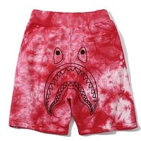 Bape street fashion shark camouflage men and women loose casual shorts Red
