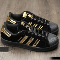 adidas superstar fashion winter suede black gold sneakers