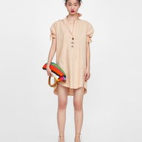 OPEN COLLAR DRESS WITH BOWS DETAILS
