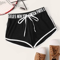 Knot Letter Tape Waist Dolphin Shorts
