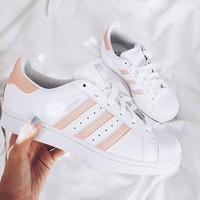 Pink striped adidas shoes