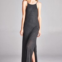 """This simple dress features a ribbed knit fabrication, scoop neckline, thin spaghetti straps, and a slit on the side. Finished with a maxi-length hemline. Partially lined with matching material ( From top to 1"""" before side slit). Pair with gladiator sandals"""