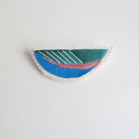 Embroidered abstract brooch in emerald green, bright blue and pink on cream muslin with cream felt backing Spring fashion denim jacket flair