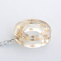 Unique winter is coming handmade ring-shaped resin pendant with tiny gold snowflakes encased in resin on a sterling silver chain