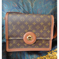 Vintage Louis Vuitton rare brown and monogram shoulder purse with bullet eye turn lock closure. Chic and mod LV vintage bag