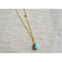 Turquoise sideways gold necklace