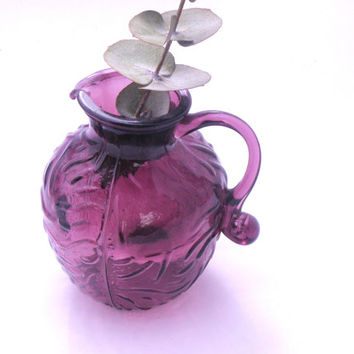 Purple vintage glass small jug-style vase - delicate and pretty with an embossed pressed design and a handle. Depression glass. Amethyst.