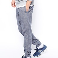 ASOS Regular Sweatpants In Woven Mini Check at asos.com
