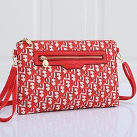 Christian Dior embroidered letters ladies shopping cosmetic bag clutch Red
