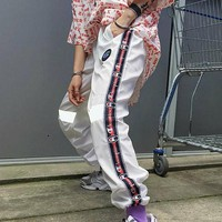 Champion makes a string of ancient silk ribbon to receive the feet of thin woven reflective casual trousers loose and easy to match for both men and women