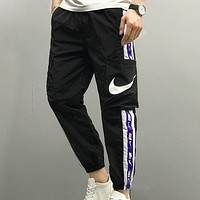 NIKE New fashion embroidery letter hook print couple pants Black