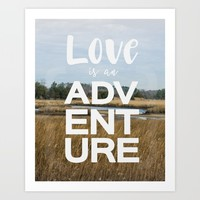 love is an adventure typography quote Art Print by Studiomarshallarts