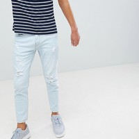 Pull&Bear slim jeans in light blue with rips at asos.com