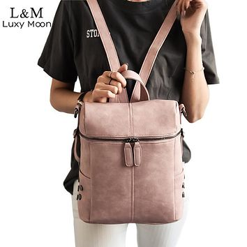 Women Leather Convertible Backpack/ shoulder Bag With Metal Studs