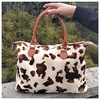Limited Time Sale! Ready, Set, Go .. Faux Fur Cow Print Weekender Tote Bag