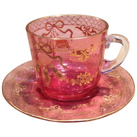 Moser Cranberry Cup And Saucer with Raised Gold Gilding c1900