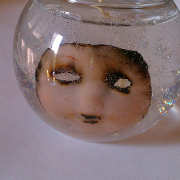 Scary doll face candle