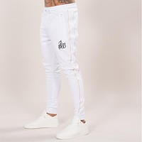 2017 GYMS New Men Pants Compress Cotton Leggings Sweatpants Fitness Workout Sporting Fitness Male Breathable Skinny Joggers