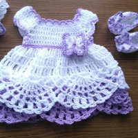 Crochet baby dress, shoes and headband in white and purple colors
