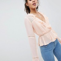 ASOS DESIGN Tall wrap top with ruffle and lace insert in pink at asos.com