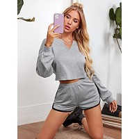 SHEIN Notch Neck Crop Pullover and Contrast Binding Dolphin Shorts Set