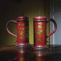 """A pair of William and Mary scarlet japanned """"Bun Flagons"""", circa 1700 