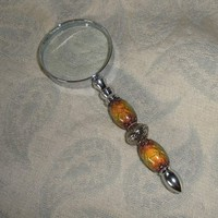 Fun gift a 10X magnfier with mood beads   pretty too in the mood 2 read