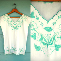 1980s. white mexican top with teal embroidery. m-l