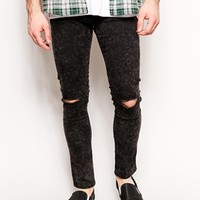 ASOS Super Skinny Jeans In Washed Black With Rip