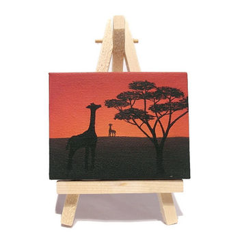 African Landscape Miniature Art - acrylic painting of African plains at sunset, with giraffe and tree silhouette. Mini canvas with easel