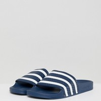 adidas Originals Adilette Sliders In Navy 288022 at asos.com
