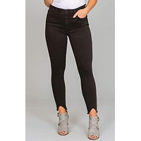 Connie Kut from the Kloth High Rise Curve Raw Hem Jeans