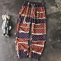 LV Fashion New Monogram Print Women Men Pants Brown