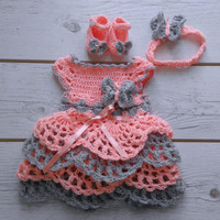 Peach grey crochet baby dress with matching crochet headband and butterfly booties