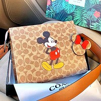 COACH x DISNEY co-branded graffiti print clutch bag
