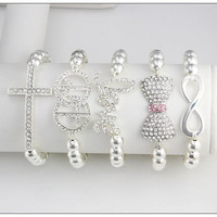 Arm Candy: 5 Piece Crystal Cross Love Peace Infinity & Bow Sideways Fasion Stacked Bracelet Set