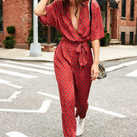 UO Bezel Wrap Belted Jumpsuit | Urban Outfitters