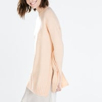 Long sweater with side slits