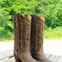 Leather boots with braided detail.